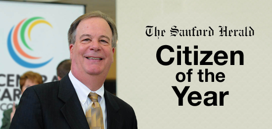Dr Marchant and text Citizen of the Year