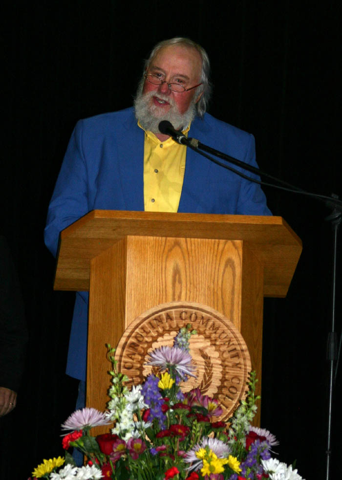 Click to enlarge,  County and pop music legend Charlie Daniels received a Lifetime Achievement Award at the 23rd Annual Central Carolina Small Business Banquet, held May 8 at the Dennis A. Wicker Civic Center, in Sanford. Daniels, born in Wilmington, said he learned to play guitar while spending his teen years in the town of Gulf near the Lee-Chatham county line, and still has 'tar on his heels'. He thanked the crowd of 450 for still considering him one of them. The banquet, sponsored by the Chamber and Central Carolina Community College's Small Business Center, also recognized Bob Patterson, senior vice president of First Bank, in Sanford, as Small Business Advocate of the Year, and Robert and Peggy Smith, owners of Smith's Coffee and Premium Water Co., in Sanford, as Small Business Persons of the Year.