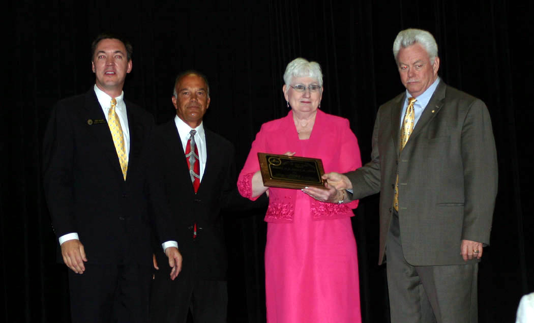 Click to enlarge,  Robert Smith (right) and Peggy Smith (second from right), owners of Smith's Coffee and Premium Water Co., in Sanford, were honored as Small Business Persons of the Year at the 23rd Annual Central Carolina Small Business Banquet, held May 8 at the Dennis A. Wicker Civic Center, in Sanford. Presenting the award were Chet Mann (left), chairman of the Sanford Area Chamber of Commerce, and Alan Dossenbach (second from left), of the Chamber. The Chamber and the Small Business Center of Central Carolina Community College put on the event. Charlie Daniels, country and pop music legend, was the guest of honor for the banquet and received a Lifetime Achievement Award for his musical career. Robert Patterson, senior vice president of First Bank, in Sanford, was honored as the Small Business Advocate of the Year.