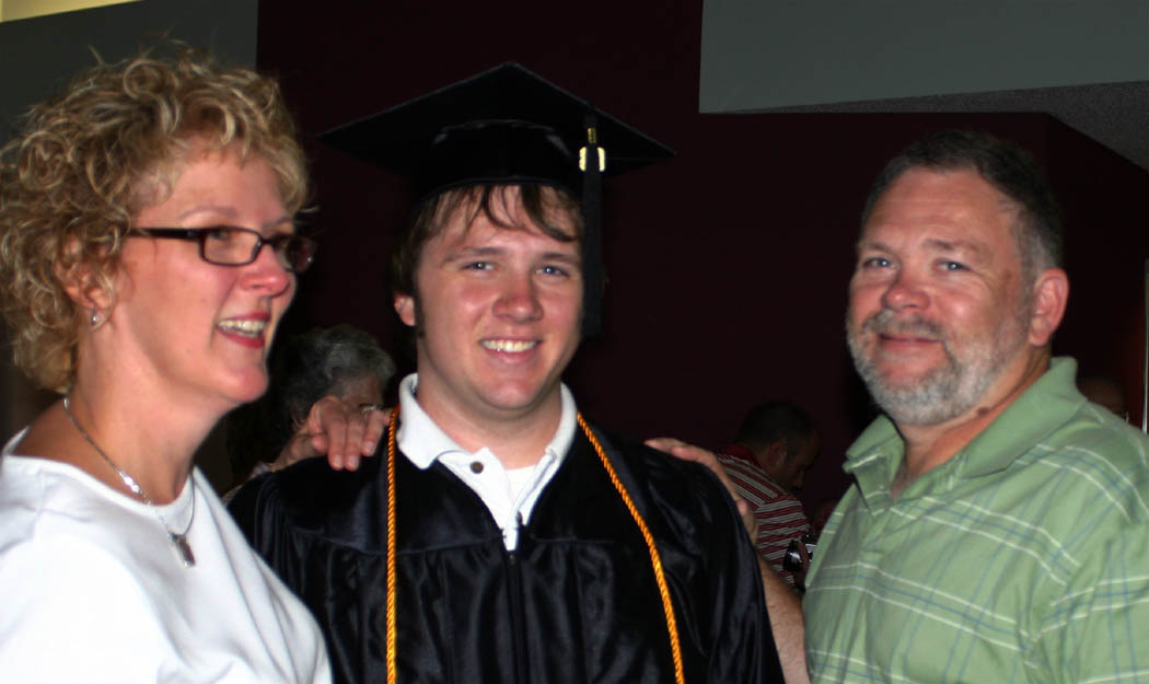 Click to enlarge,  Michael Grenier (center), of Lillington, gets warm congratulations from his mother, Donna Grenier (left) and father, Kenneth Grenier, following his graduation from Central Carolina Community College Friday. Michael earned his AAS in Industrial Systems Technology. Now he has his sights set on finding a job.
