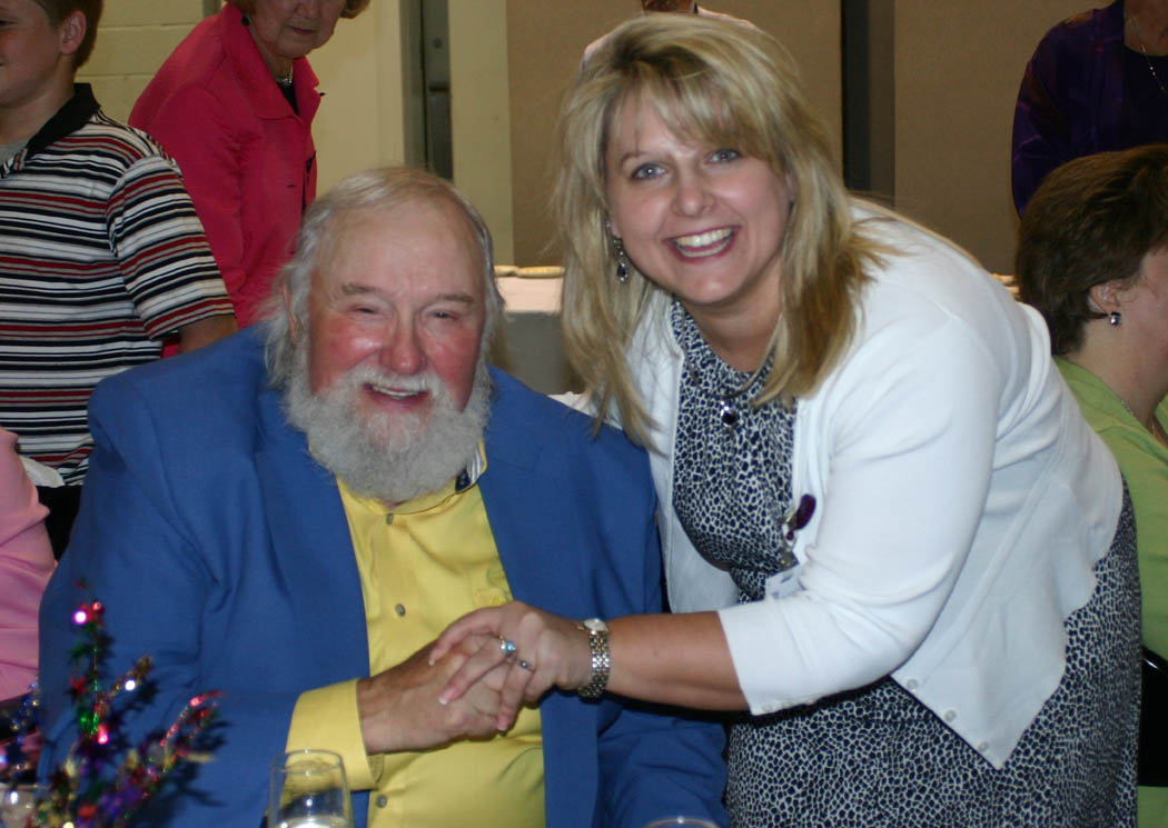 Click to enlarge,  County and pop music legend Charlie Daniels (left) greets Jo Jarrett, incoming president of the Sanford Area Chamber of Commerce, during the 23rd Annual Central Carolina Small Business Banquet, held May 8 at the Dennis A. Wicker Civic Center, in Sanford. Daniels received a Lifetime Achievement Award for his musical career. He was born in Wilmington, but said he learned to play guitar while spending his teen years in the town of Gulf, near the Lee-Chatham county line, and still has 'tar on his heels'. He thanked the crowd of 450 for still considering him one of them. The banquet, put on by the Chamber and Central Carolina Community College's Small Business Center, also recognized Bob Patterson, senior vice president of First Bank, in Sanford, as Small Business Advocate of the Year, and Robert and Peggy Smith, owners of Smith's Coffee and Premium Water Co., in Sanford, as Small Business Persons of the Year.