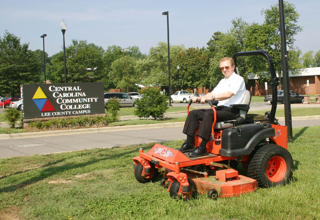Click to enlarge,  President Matt Garrett of Central Carolina Community College retires as of Sept. 1 after 21 years with the college. He has jokingly said that, over the years, he has done almost every job at the college except mow the grass. He recently corrected that deficiency by mounting one of college's large mowers at the Lee County Campus and mowing a large swath of lawn.