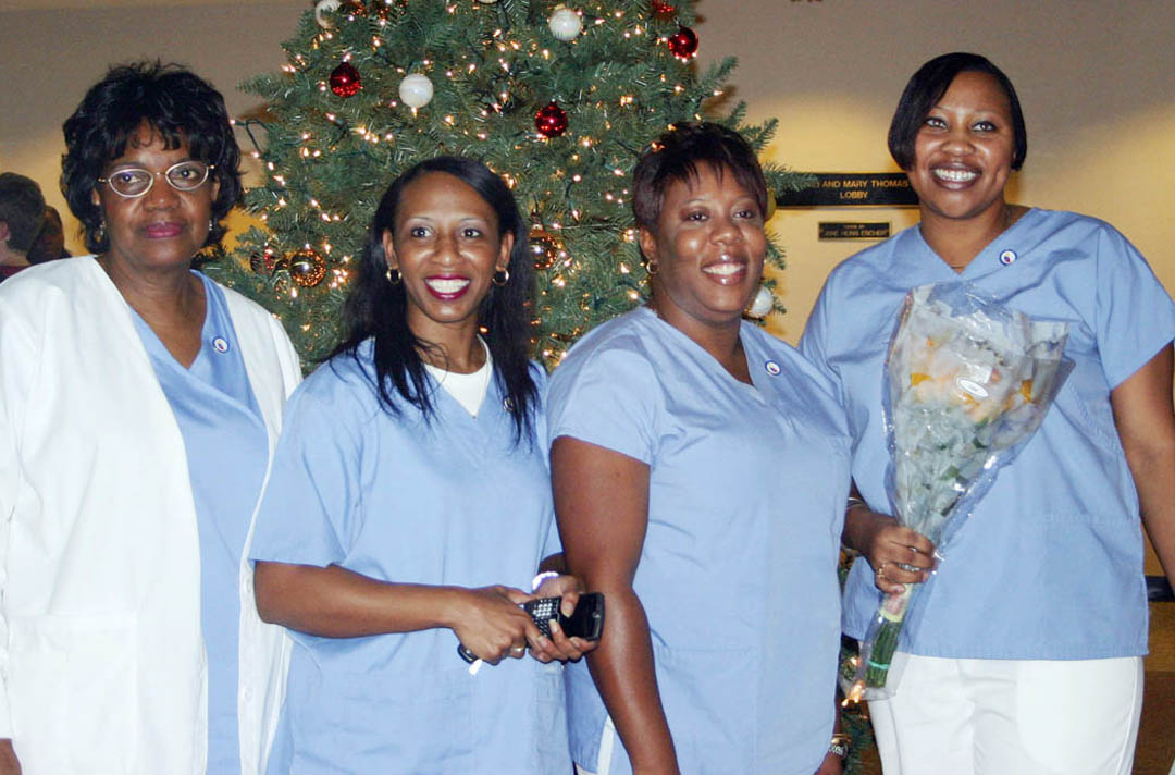 Click to enlarge,  Smiles reigned at the Central Carolina Community College-Lee County Continuing Education Department's Medical Programs Graduation. More than 100 of the graduating students took part in the exercise at the Dennis A. Wicker Civic Center Dec. 17. Among them were Nursing Assistant-I graduates (from left) Rosa Fox, Tracy McCormick and Taniya Alexander, all of Sanford, and Tamicha McKinnon, of Carthage.