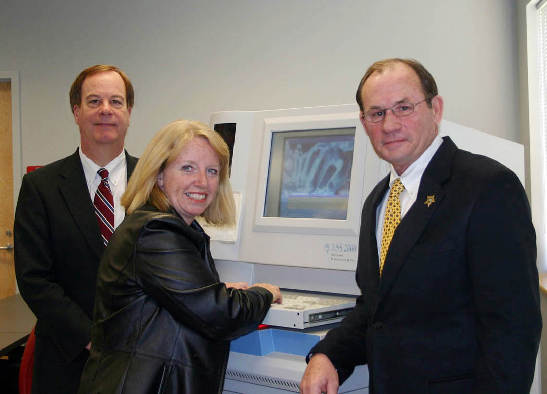 Click to enlarge Central Carolina receives fingerprint machine from Harnett Sheriff's Department