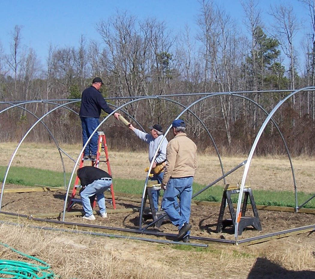 Click to enlarge,  Gardening time is here and Central Carolina Community College staff is putting up a hoop house at the college's West Harnett Center to house the garden of the new 'Introduction to Sustainable Vegetable Production' course being offered at the center. Ronnie Measamer, physical plant manager, and staff, Danny Dean, Joel Oldham and Johnny Dickens, will cover the hoop frame with plastic to provide a protected area for the growing vegetables. The nine-week Continuing Education course runs 1 p.m.-4 p.m. Tuesdays, March 24-May 19. To sign up, call the center at (910) 498-1210. If interested in a sustainable vegetable production class on Wednesday evenings, contract instructor Rob VanderVoort at the same number, ext. 1004. The center is located at 145 Olive Farm Drive, in the Western Harnett Industrial Park, south of Sanford and north of the intersection of highways 87 and 27.