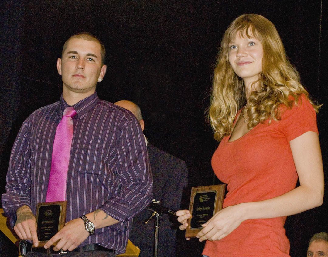 Click to enlarge,  Central Carolina Community College students Matthew Winch (left), of Carthage, and Kathryn Schonder, of Sanford, were among students honored at the college's 14th annual Academic Excellence Awards program May 6 at the Dennis A. Wicker Civic Center. Both received a Scholar Athlete Award for excellence in both academics and athletics. Winch played on the basketball team and Schonder, on the volleyball team. Also honored as a Scholar Athlete was Kyle McCarthy, of Sanford, who was not present. Schonder and McCarthy were also honored for being selected for Who's Who Among Students in America's Junior Colleges. The college and its departments honored 66 graduating students for excelling academically, being outstanding students, serving as Ambassadors, being selected for Who's Who Among Students in America's Junior Colleges, and other achievements.