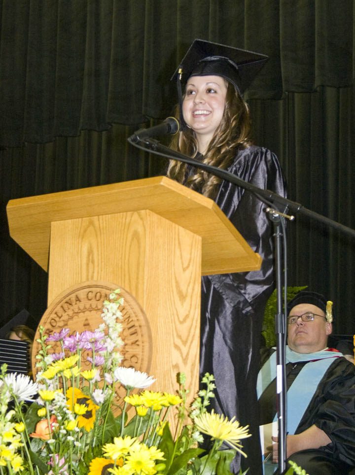 Click to enlarge,  Graduating student Amber Clark delivered one of the addresses Thursday at Central Carolina Community College's 46th Spring Commencement at the Dennis A. Wicker Civic Center. Clark, of Lee County, received her Associate in Arts-University Transfer degree. Members of the graduating class earned 284 degrees, 107 diplomas, and 348 certificates, with some earning more than one diploma or certificate. About 250 graduating students took part in the commencement exercises.