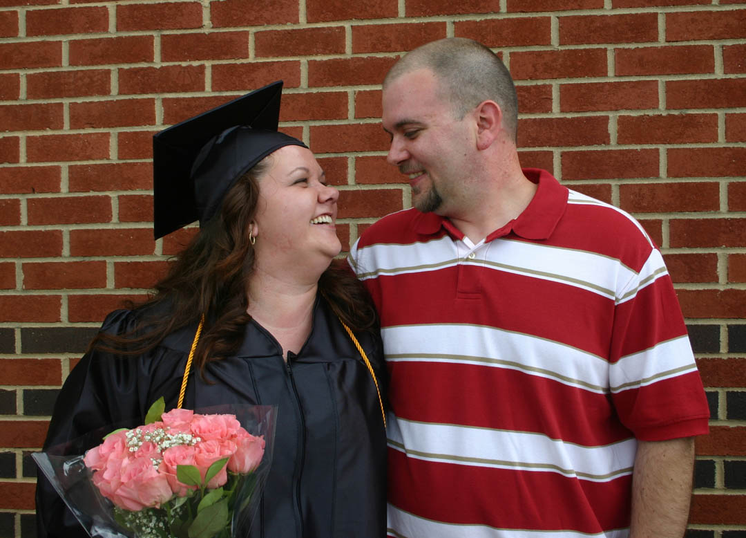 Click to enlarge,  Holly Williams, of Chatham County, shares a smile with her boyfriend, Jay Lento, after receiving her Associate in Applied Science in Accounting Thursday at Central Carolina Community College's 46th Spring Commencement at the Dennis A. Wicker Civic Center. Williams now plans to attend Appalachian State University to obtain her bachelor's in accounting. The graduates completed their studies for 284 degrees, 107 diplomas, and 348 certificates, with some earning more than one diploma or certificate. About 250 graduating students took part in the commencement exercises.
