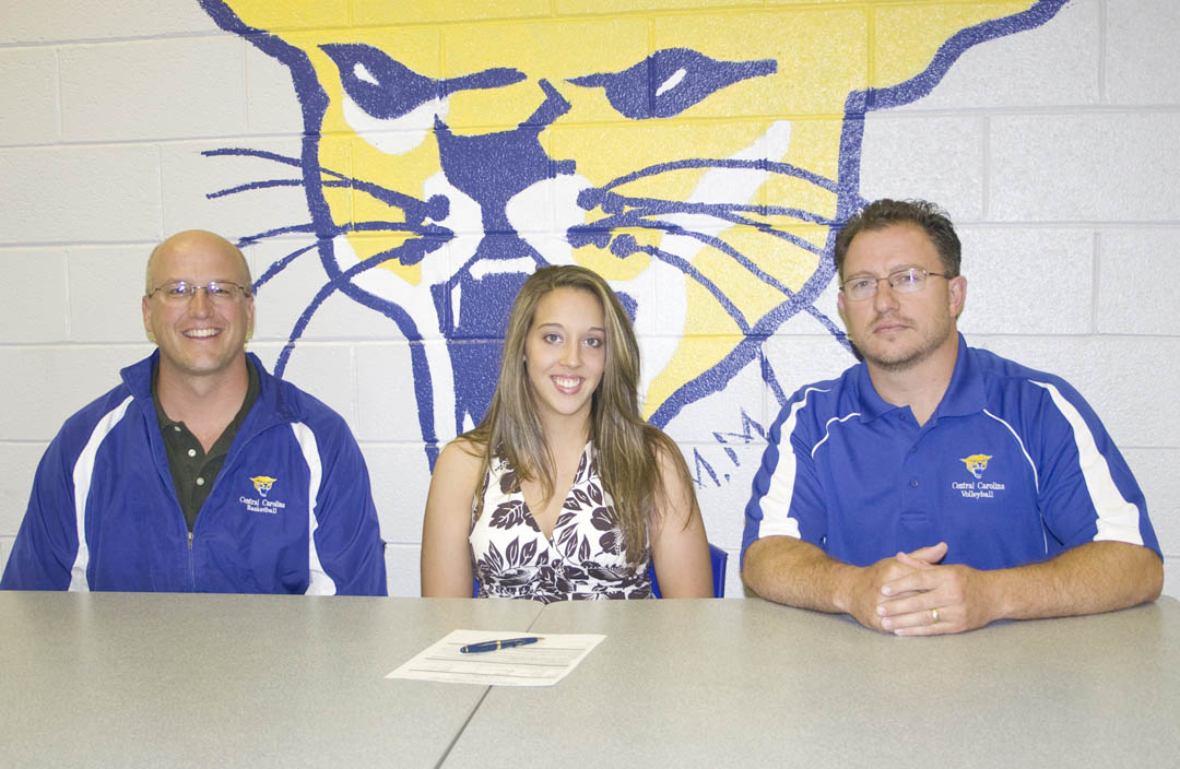 Click to enlarge,  Jessica Thrash (center), of Fayetteville, has signed her letter of intent to play volleyball for Central Carolina Community College's Cougars. Athletic Director Mike Neal (left) and coach Bill Carter said the outside/middle hitter will provide the Cougars with a lot of offensive power. Thrash, a Veterinary Medical Technology student, is the daughter of Ray and Joy Thrash.