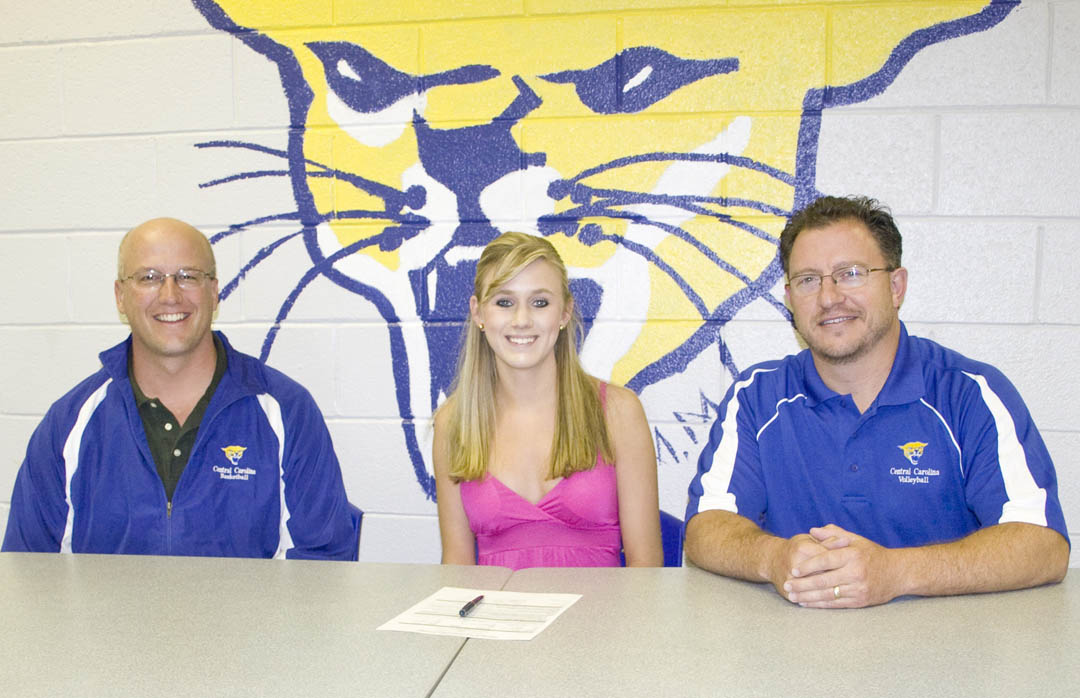 Click to enlarge,  Delaney Warcup (center), of Lee County, has signed her letter of intent to play volleyball for Central Carolina Community College's Cougars. Present at the signing were the college's Athletic Director Mike Neal (left) and coach Bill Carter. Warcup is the daughter of Don and Cindy Warcup. Carter said, as starting setter, Warcup will bring maturity and experience in running the Cougar offense.