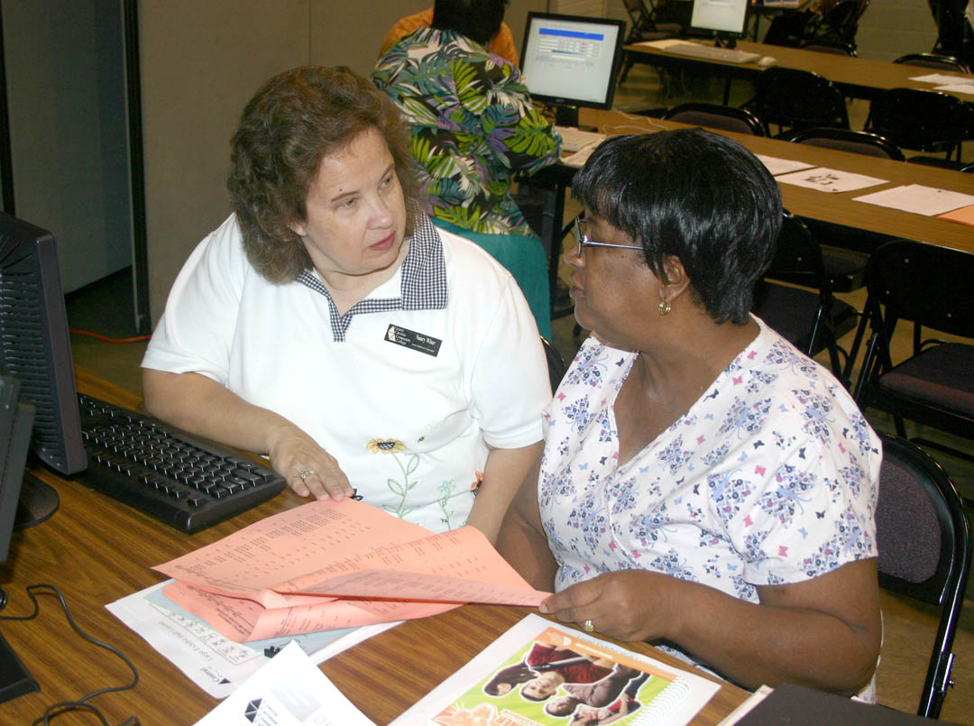 Click to enlarge,  Central Carolina Community College held fall semester open registration Aug. 19 at its campuses in Lillington, Pittsboro and Sanford. Gracie Leak (right), of Lee County, counsels with adviser Nancy Wiser, Early Childhood Instructor, about Early Childhood classes during registration at the Dennis A. Wicker Civic Center, in Sanford. Enrollment figures show an increase over last year. By the time open registration closed on the 19th, 4,276 students had enrolled, about 70 more than had enrolled by the end of the first week of classes in fall 2008. The figure for fall 2009 will increase as students do late enrollment, add/drops, and minimester enrollment. Classes start Aug. 24.