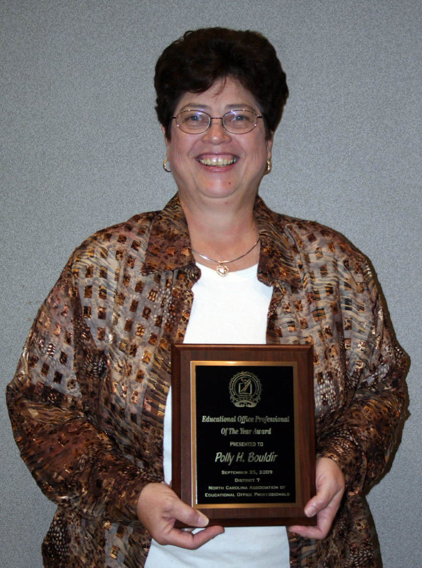 Click to enlarge,  Polly Bouldin, of Central Carolina Community College, has been named the Educational Office Professional of the Year by District 7 of the North Carolina Association of Educational Office Professionals. She has been the site supervisor at the college's West Harnett Center since 2001. The award was presented during the District 7 meeting Friday, Sept. 25, at the Dennis A. Wicker Civic Center, in Sanford. District 7 includes members in Lee, Moore, Randolph, Stanly, Montgomery, Anson, Richmond, Union and Scotland counties. Bouldin will now compete for state-level EOP against the winners from the organization's 13 other districts.