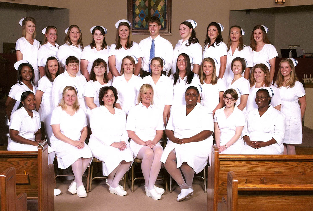 Click to enlarge,     The 2009 Associate Degree Nursing (ADN) graduates of Central Carolina Community College earned a pass rate of 93 percent on the National Council Licensure Examination-Registered Nurse (NCLEX-RN) the first time they sat the test. All are now registered nurses. The North Carolina Board of Nursing uses the NCLEX, prepared by the National Council of State Boards of Nursing, to measure competence for graduates of board-approved programs of nurse education. The college's 2009 ADN graduates are: (front row, from left): Leishia Jamece Williams, of Coats; Julie Hatch, of Fuquay-Varina; Vicky Barker Long, of Sanford; Lisa Marie Millard, of Cameron; Larnette Tenequa Moore, of Lillington; Gela DeAndra Spivey, of Sanford; and Leah Sandra Pwiti Underwood, of Knightdale; (middle row, from left) Kathy Marie McArthur, of Erwin; Hilary Gale Revels, of Fuquay-Varina; Janice Marie Hulings, of Sanford; Ashley Renee Hanna, of Cameron; Jenna Fuller Suggs, of Bear Creek; Savannah Suzanne Fuller, of Sanford; Pamela Michelle Norris and Amanda Faye Baker, of Holly Springs; Allison Davis Glasson, of Angier; Rachel Michele Barbour, of Willow Spring; and Katherine Jackson Simpson, of Fuquay-Varina; and (back row, from left): Melissa Ann Cordevant and Jennifer Leigh McNeill, of Sanford; Rachel Fay Ingram, of Angier; Lauren Nichole Parrish, of Sanford; Stephany Lee Mason, of Spring Lake; Andrew Ferrier Crum, of Chapel Hill; Elizabeth Frances Terwilliger, of Sanford; Samantha Lynn Truitt, of Bear Creek; Angela Nichole Brown, of Erwin, and Stormy Ray Davis, of Fuquay-Varina. Not pictured are graduates Cindy Michele Keefe, of Apex; and Susana Cano Prieto, of Coats.