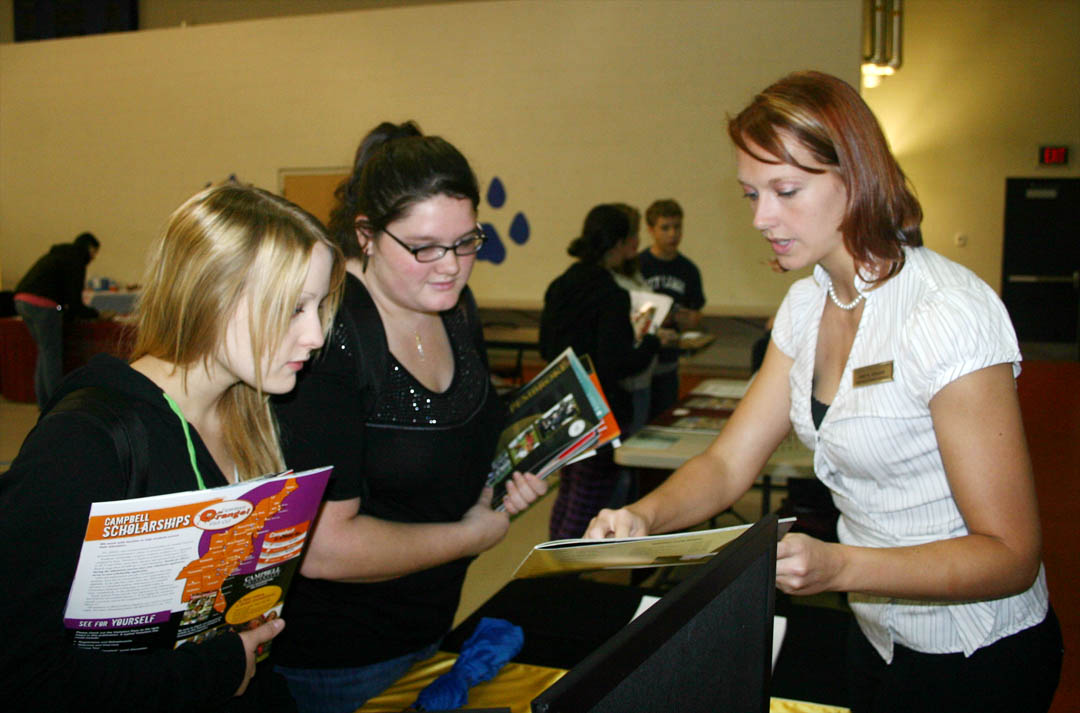 Click to enlarge,  Admissions counselors and representatives from almost 20 senior educational institutions visited Central Carolina Community College's Lee County Campus Nov. 19 for the college's University Transfer Day. They shared what their institutions have to offer students who complete their associate degree or university transfer programs at CCCC. Linsey Rimmer (left), of Siler City, was excited when she heard that UNC-Pembroke has the program she's been looking for: zoology. Rimmer, an Associate in Science degree student, and Tiffany McFetters (center), also of Siler City, a Veterinary Medical Technology student, spoke with the counselors, including Amie Graham (right), assistant senior  director of admissions at Pembroke. CCCC offers the first two years of a four-year college education close to home and for a fraction of the cost of a four-year institution. These institutions come to talk to CCCC students because of the quality education Central Carolina Community College provides. For more information, visit its web site,  www.cccc.edu .