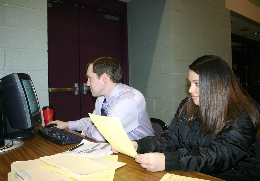 Click to enlarge,  Central Carolina Community College accounting student Ashley Desselle (right), of Cameron, Harnett County, works on her class schedule with instructor Drew Goodson during the college's spring open registration Jan. 5 at the Dennis A. Wicker Civic Center, in Sanford. Open registration also took place at the college's campuses in Pittsboro and Lillington. Classes start Jan. 7. Late registration will continue through Jan. 13 at the Student Services offices at the Chatham, Harnett and Lee campuses. For more information about programs or registration, visit the college's web site, www.cccc.edu, or call one of the campuses: Pittsboro, (919) 542-6495; Lillington,