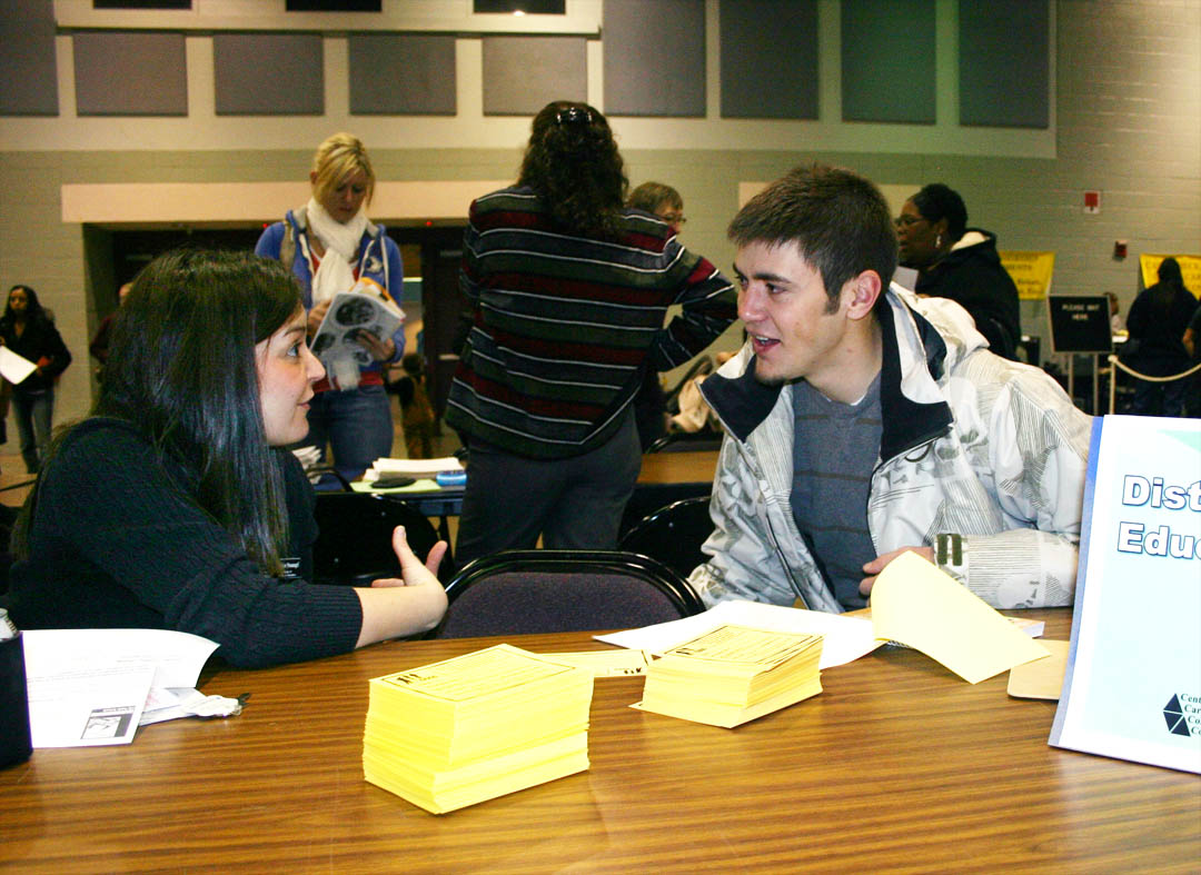 Click to enlarge,  The Dennis A. Wicker Civic Center was a busy place Jan. 5 as Central Carolina Community College students signed up for their spring semester classes during open registration. University transfer student Will Bridges (right), of Sanford, discusses taking some of his classes via the Internet with Bianka Stumpf, CCCC director of Distance Education. Bridges plans to get his associate degree and then transfer as an upperclassman to N.C. State University to major in meteorology. He said taking some of his classes online is convenient and better fits his schedule. Open registration took place Jan. 5 at the college's campuses in Sanford, Pittsboro and Lillington. Classes start Jan. 7. Late registration will continue through Jan. 13 at the Student Services offices at the three campuses. For more information about programs or registration, visit the college's web site, www.cccc.edu, or call one of the campuses: Pittsboro, (919) 542-6495; Lillington, (910) 893-9101; or Sanford, (919) 775-5401 or (800) 682-8353.