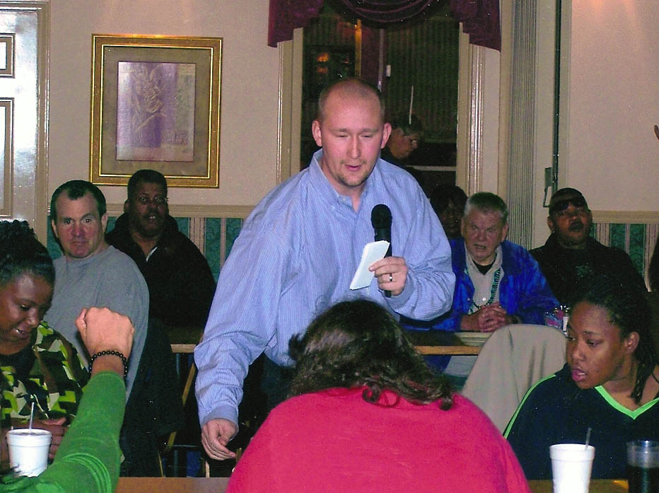 Click to enlarge,  Motivational speaker Michael Murphy (center), program director for N.C. Disability Action Network, talks with students during the Central Carolina Community College Siler City Center Compensatory Education program's Thanksgiving Awards Luncheon Nov. 12. Students were recognized for their participation and achievement in the CED programs at the Center and Chatham Trades.