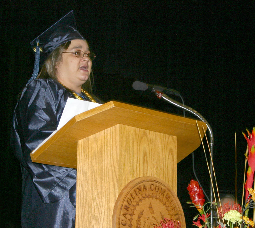 Click to enlarge,     Central Carolina Community College's Adult High School and General Educational Development programs held their graduation exercises Jan. 21 at the Dennis A. Wicker Civic Center. Teresa Ward, of Chatham County, received her high school diploma with honors. She was one of three student speakers for the event. The graduation was particularly special for her because her son, Darryl Crim, also received his. Ward was one of 272 residents of Chatham, Harnett and Lee counties who completed their studies for a high school or GED diploma at the college this semester. About 150 turned out for the graduation ceremony.