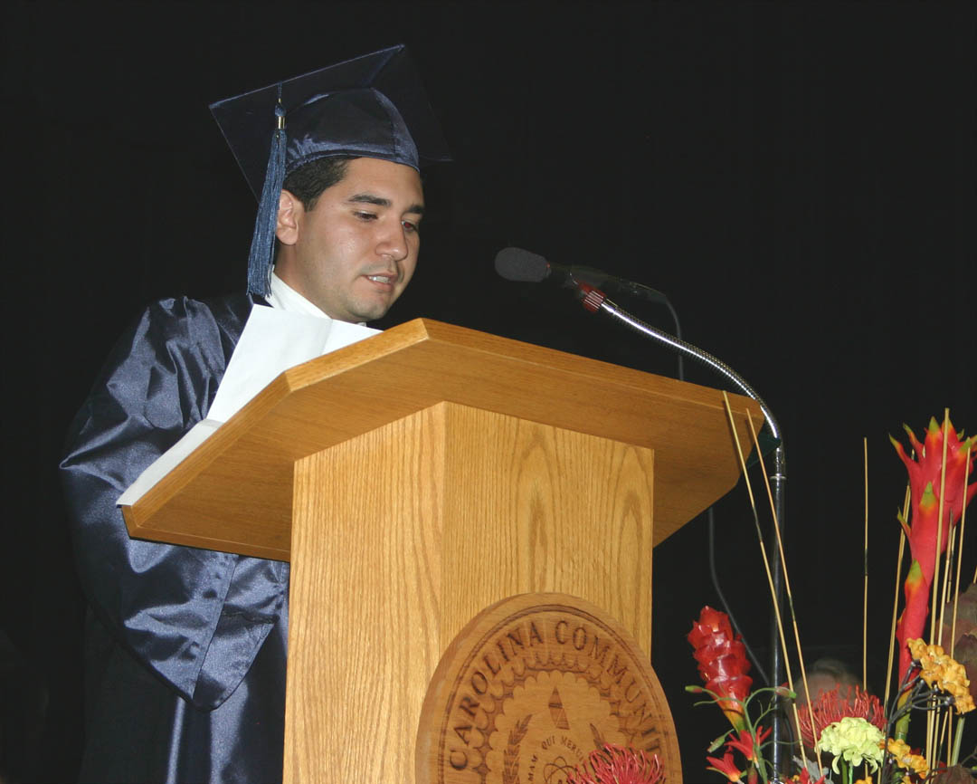 Click to enlarge,     Mark Valle, of Harnett County, was one of three student speakers at the Central Carolina Community College Adult High School/GED graduation Jan. 21 at the Dennis A. Wicker Civic Center. Valle dropped out of high school to help support his family, but later came to CCCC to earn his General Educational Development diploma. He now plans to go on to college to study architecture or computer technology. He was one of 272 residents of Chatham, Harnett and Lee counties who completed their studies for a high school or GED diploma at the college this semester. About 150 turned out for the graduation ceremony.