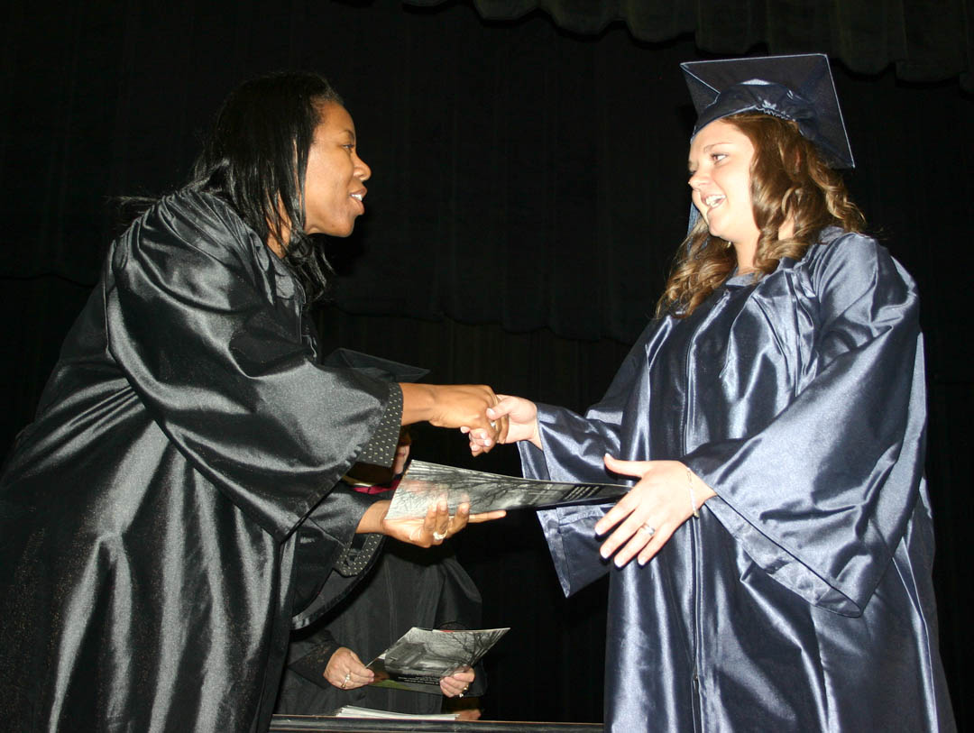 Click to enlarge,  Tiffany Adams (right) is congratulated by Central Carolina Community College Vice President Stelfanie Williams, Economic & Community Development Division, at the college's Adult High School/GED graduation Jan. 21 at the Dennis A. Wicker Civic Center. Adams, who received her General Educational Development diploma, was one of 272 residents of Chatham, Harnett and Lee counties who completed their studies for a high school or GED diploma at the college this semester. About 150 turned out for the graduation ceremony.