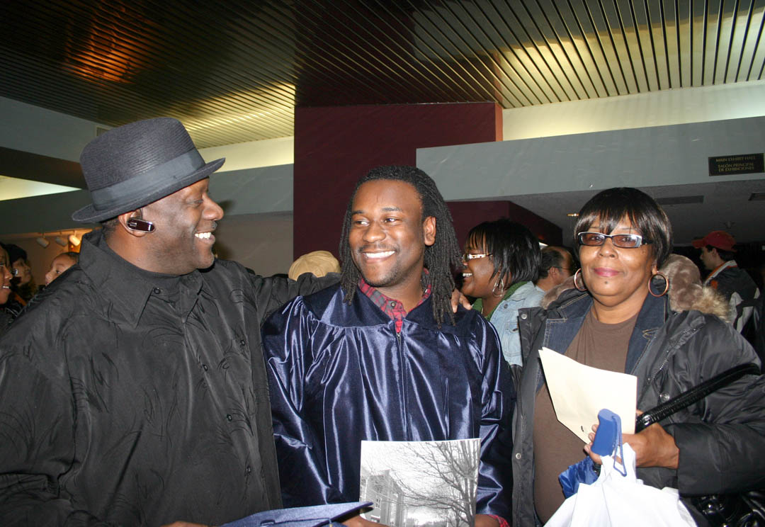 Click to enlarge,  Jaspen Pratt (center) of Chatham County, his father, Ruben Pratt (left) and mother Catherine Moore are all smiles following the Central Carolina Community College Adult High School/GED graduation Jan. 21 at the Dennis A. Wicker Civic Center. Pratt dropped out of high school, but had now earned his diploma. He is already continuing his education in the college's auto body restoration program in Pittsboro. Pratt was one of 272 residents of Chatham, Harnett and Lee counties who completed their studies for a high school or General Educational Development diploma at the college this semester. About 150 turned out for the graduation ceremony.