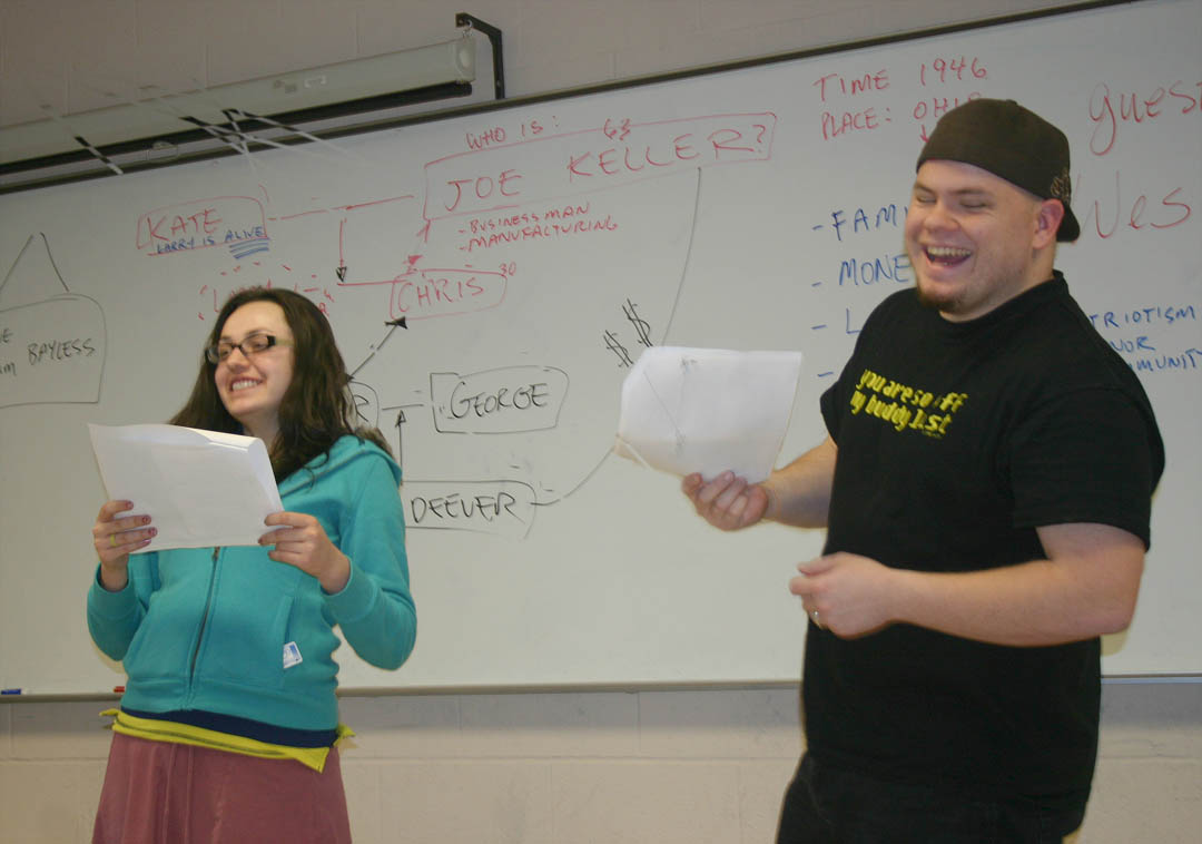 "Click to enlarge,  Central Carolina Community College's Theatre Appreciation student Caroline Griffith (left) and Broadcasting student Michael Bradshaw, both of Sanford, crack up during an impromptu reading of a scene from playwright Arthur Miller's drama ""All My Sons."" The script reading was part of a Feb. 9 class discussion on the play led by PlayMakers Repertory Theatre actor Wes Schultz. Schultz visited instructor Ellen Bland's Theatre Appreciation class on the college's Lee County Campus to discuss the play and the motivations of the characters with the students and members of the college's theater production group in preparation for their  planned trip to PlayMakers to see the production. For information about CCCC classes, visit www.cccc.edu. For more information about PlayMakers, visit  www.playmakersrep.org ."