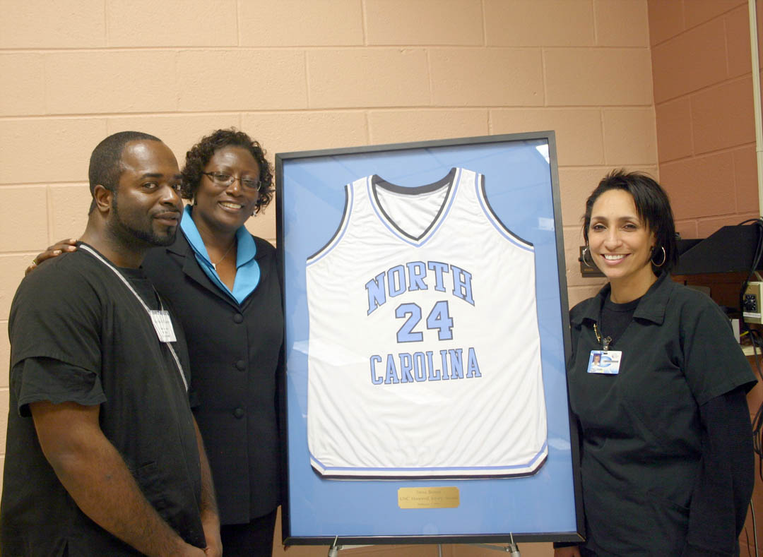 Click to enlarge,  Tresa Brown-Tomlinson (center), Assistant Superintendent for Programs at Harnett Correctional Institution and former University of North Carolina-Chapel Hill women's basketball powerhouse (1980-84), was the featured Black History Month speaker Feb. 23 at Central Carolina Community College's Harnett County Campus. Speaking with Brown-Tomlinson afterward were cosmetology students Kelvin Williams (left), of Dunn, and Letty Lomogilio, of Spring Lake. Brown-Tomlinson used her basketball experiences to encourage the audience members to believe in themselves, have good attitudes and give back to their communities. Among the many honors she has received are having UNC retire her jersey (center) in 1995 and being named an Atlantic Coast Conference Women's Basketball Tournament Legend in 2008.