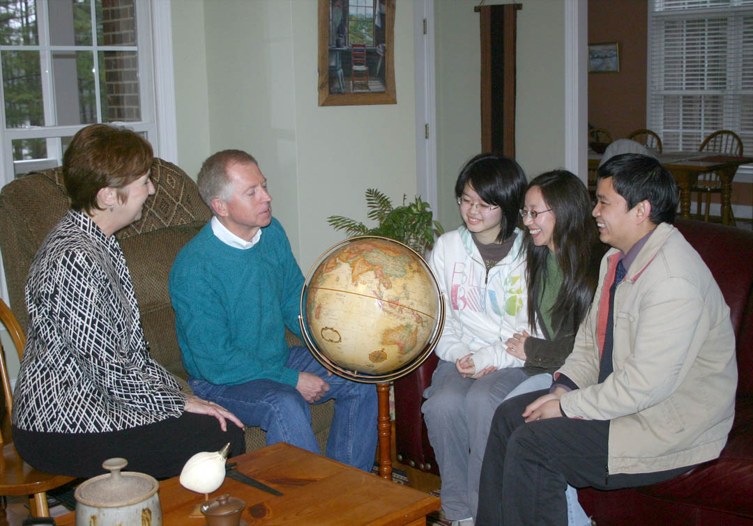 Click to enlarge,  Shuya Che (second from right), a professor at Nanjing Normal University, in China, and currently the instructor for Central Carolina Community College's Confucius Classroom, in Sanford, enjoyed a month-long visit during February from her daughter Yixiao Cui (third from right), a student at Nanjing Foreign Language School, and husband Xiangyang Cui (right), a professor of economics at Nanjing University of Economics and Finance. While teaching at CCCC for two years, Che is living with (from left) Becky and Matt Garrett, of Sanford. The Garretts also hosted her family and showed them some of the sights in North Carolina, including the beach and the Biltmore Estate. During the visit to the United States, the family also took a tour of Baltimore, Philadelphia, New York, and Washington, D.C. Yixiao had the opportunity to sit in on several days of classes at Lee County High School. The family was impressed with America and Americans and said they hope more Americans will visit China and get to know the Chinese people.