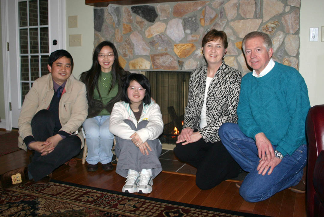Click to enlarge,  Shuya Che (second from left), a professor at Nanjing Normal University, in China, and currently the instructor for Central Carolina Community College's Confucius Classroom, in Sanford, enjoyed a month-long visit during February from her husband, Xiangyang Cui (left), a professor of economics at Nanjing University of Economics and Finance, and daughter Yixiao Cui (center), a student at Nanjing Foreign Language School. While teaching at CCCC for two years, Che is living with Matt (right) and Becky Garrett, of Sanford. The Garretts also hosted her family and showed them some of the sights in North Carolina, including the beach and the Biltmore Estate. During the visit to the United States, the family took a tour of Baltimore, Philadelphia, New York, and Washington, D.C. Yixiao also had the opportunity to sit in on several days of classes at Lee County High School. The family was impressed with America and Americans and said they hope more Americans will visit China and get to know the Chinese people.