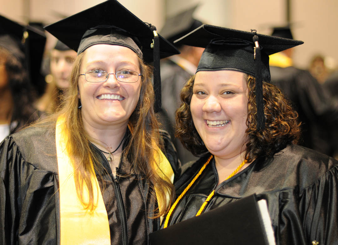 Click to enlarge,  Central Carolina Community College graduates Emily Needham (left), of Chatham County, and Tanya Haislip, of Lee County, are all smiles following the college's graduation ceremony May 13 at the Dennis A. Wicker Civic Center. Both received their Associate in Applied Science in Accounting. While students, Needham served as a Student Ambassador and Haislip was SGA president.