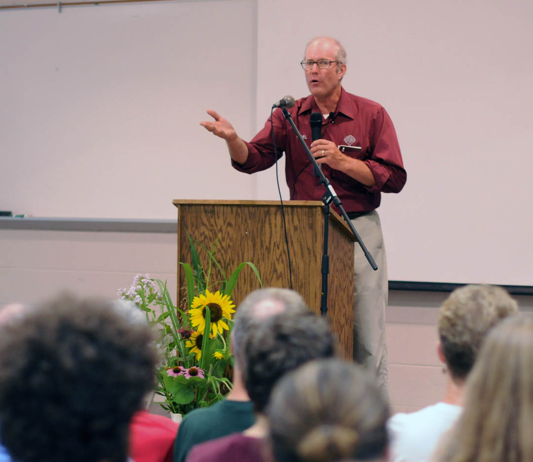 Click to enlarge,  Joel Salatin (center), nationally known sustainable farmer and agricultural writer, shares his passion for and experience with sustainable farming with a gathering of about 400 people during a June 30 visit to Central Carolina Community College's Chatham Campus, in Pittsboro. Salatin's Polyface Farms, in Virginia's Shenandoah Valley, is a working example of the potential for local food production and distribution to help solve the challenges of biosecurity, food-borne pathogens, energy, and humane husbandry. In his presentation, 'Local Food to the Rescue,' Salatin spoke of his family's use of environmentally enhancing farming practices and the importance and benefits of incorporating sustainable farming practices throughout the world. The college's Natural Chef and Sustainable Agriculture programs at its Chatham Campus, Carolina Farm Stewardship Association, and N.C. Tobacco Trust Fund Commission sponsored his appearance. To see a video of Salatin's presentation, visit the college's Web site,  www.cccc.edu , click on the YouTube icon, and then click on 'Joel Salatin Talk.' To purchase a DVD of the presentation, contact Janice Escott, CCCC Natural Chef Program coordinator, at (919) 542-6495 or  jescott@cccc.edu . For more information on CCCC's Natural Chef and agriculture programs, visit  www.cccc.edu/naturalchef  or  www.cccc.edu/sustainableag . For information about Polyface Farms, visit  www.polyfacefarms.com
