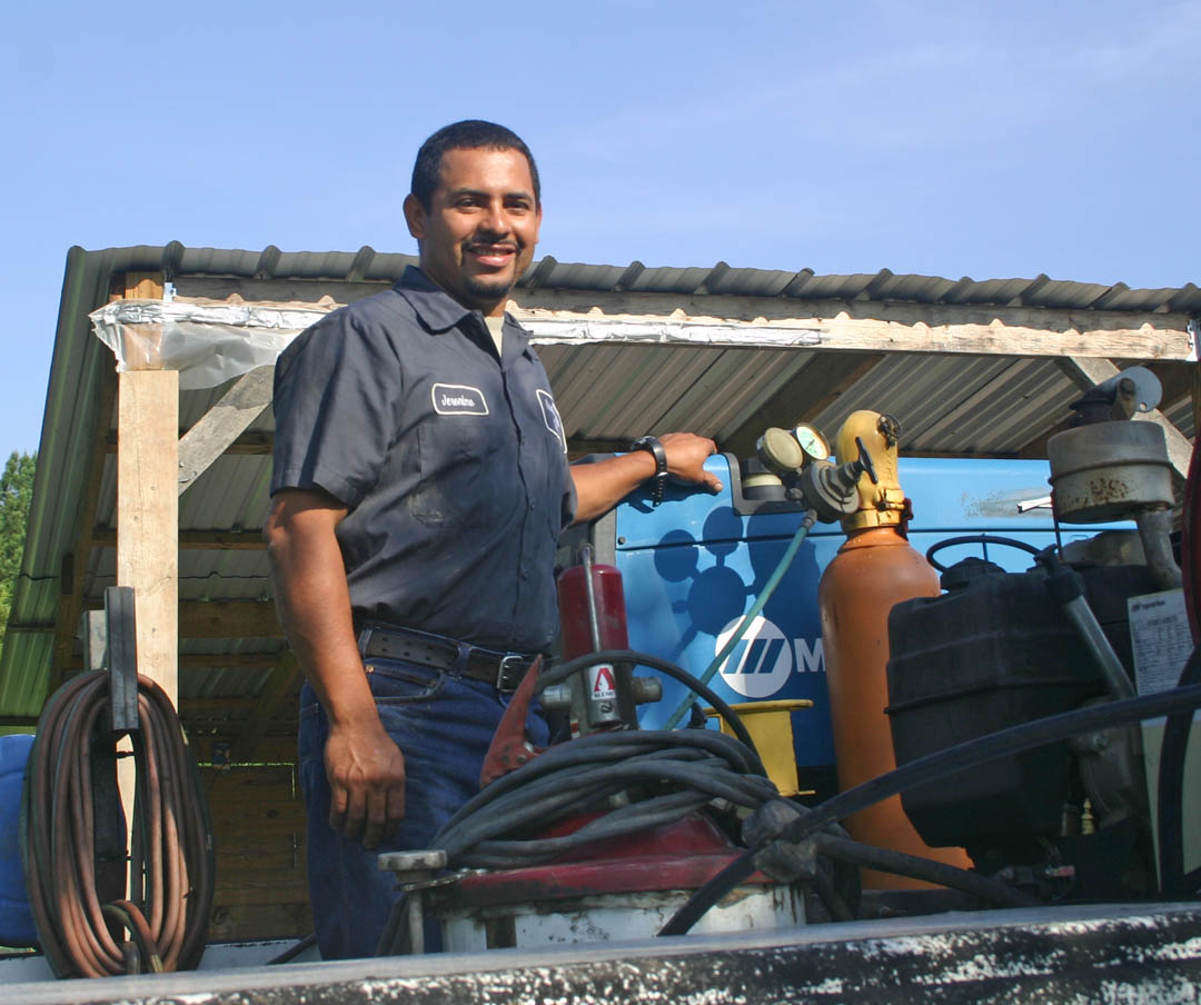 Click to enlarge,  Jeronimo Prieta Medina stands in his truck bed, surrounded by the equipment he uses in his heavy equipment repair business, JP Mechanic and Welding, based at his Siler City home. He earned certificates in welding, hydraulics and maintenance at Central Carolina Community College, which enabled him to be an in-demand employee for several heavy equipment companies. In 2009, he went to the college's Small Business Center in Chatham County and learned how to establish and operate his own successful heavy equipment repair business. He works hard, but enjoys being his own boss. The business can be reached at (919) 650-7438.