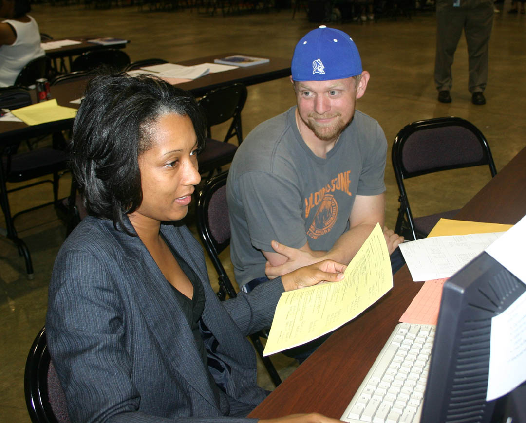 Click to enlarge,  John Bair (right), of Pittsboro, listens as Chanda Allen, Central Carolina Community College English instructor, assists him in registering for the fall semester during the college's Open Registration Tuesday, Aug. 17, at the Dennis A. Wicker Civic Center. Bair plans to earn both a Nursing degree and an Associate in Arts degree at the college. Fall classes begin Monday, Aug. 23. Late registration extends through 3 p.m. Friday, Aug. 27, at the college's campuses in Chatham, Harnett and Lee counties. For more information on registering or classes, visit the college's Web site,  www.cccc.edu .