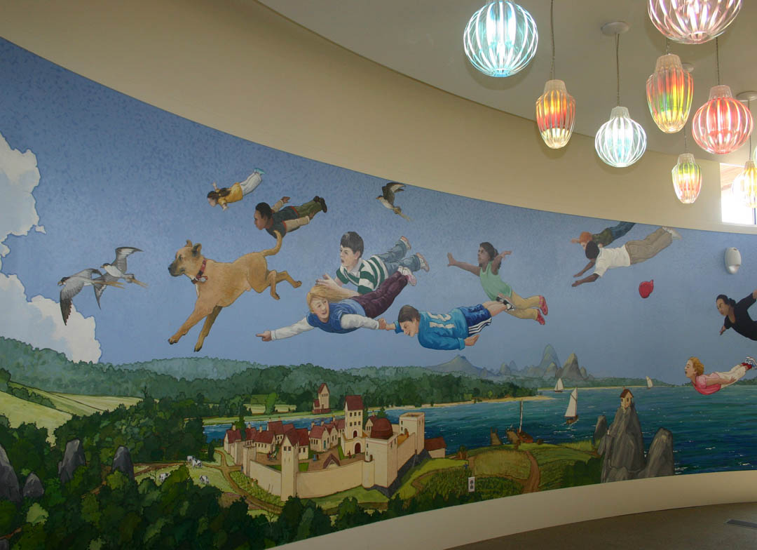 Click to enlarge,  A mural by artist Michael Brown that encourages children's imaginations to take flight covers the wall of the circular children's reading room at the new Chatham Community Library at Central Carolina Community College's Chatham County Campus. The college and Chatham County celebrated the opening of the joint-use county-college library and the college's Sustainable Technologies Center with a Sept. 20 ribbon cutting and open house. Both facilities are green construction and expected to receive the U.S. Green Building Council's Leadership in Energy Efficiency and Design gold level certification. A crowd estimated at more than 600 attended the event.