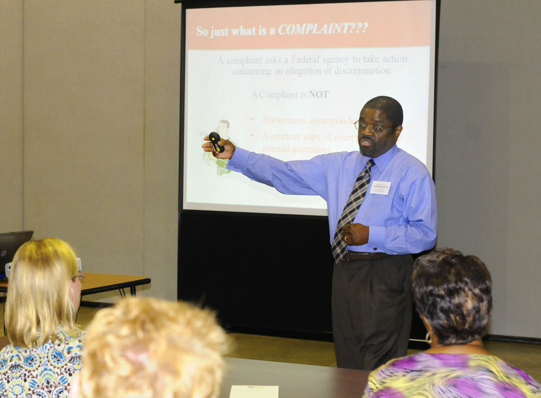 Click to enlarge,  Mose Dorsey, administrative officer of the N.C. Department of Commerce Division of Workforce Development, outlines the process by which officials need to handle workplace discrimination complaints. Dorsey spoke during a Sept. 23 workshop hosted by Central Carolina Community College and the Triangle South Workforce Development Board at the college's Dennis A. Wicker Civic Center. The workshop was for area employment security workers and workforce development officials. Dorsey is a former discrimination investigator with the federal Justice Department. For more information about the Triangle South Workforce Development program, which includes Lee, Harnett, Chatham and Sampson counties, call (919) 777-2122 or visit  www.trianglesouthworkforce.com .