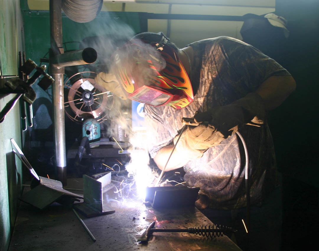 Click to enlarge,  Central Carolina Community College welding student Jason Morris works on a SIP metal angle weld during a Continuing Education JobsNOW class at the college's Harnett County Campus. Morris completed several welding certifications in the class and, with the skills and certifications he gained, has now started his own welding business in Apex.