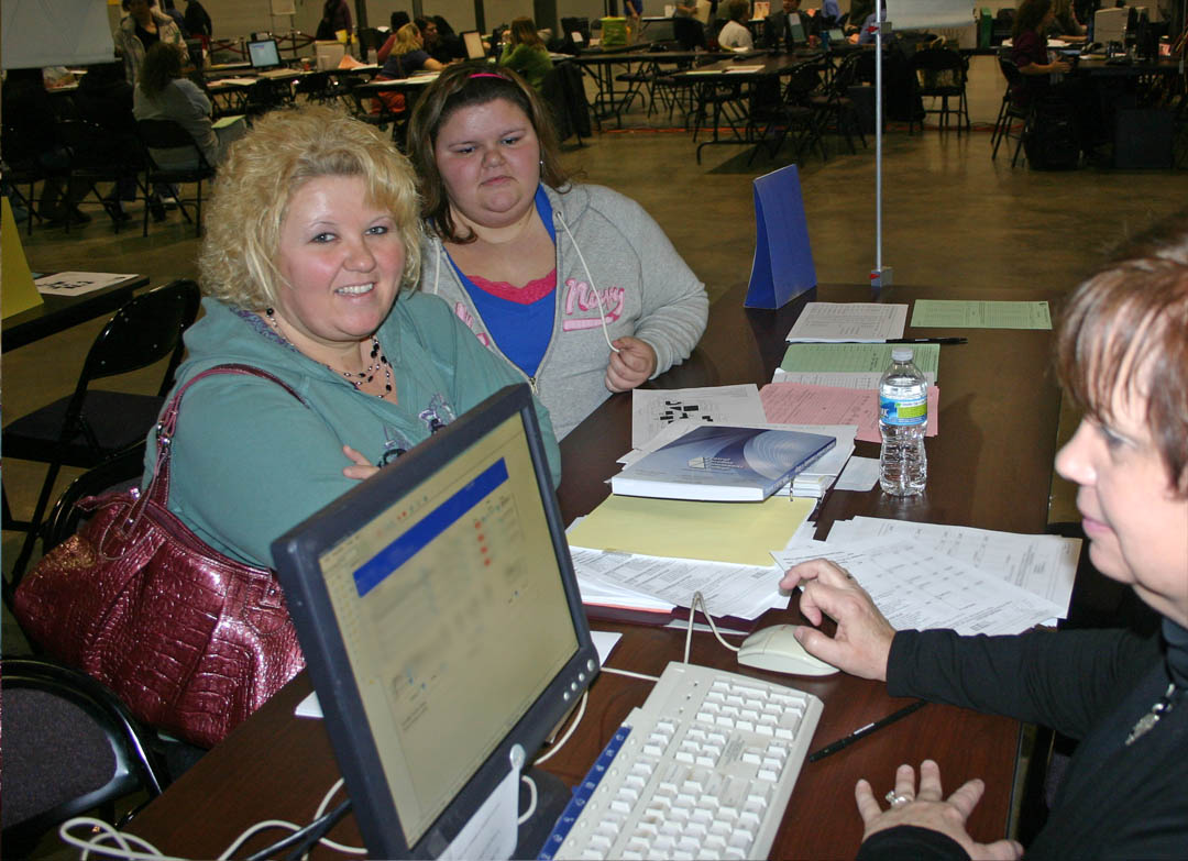Click to enlarge,  Central Carolina Community College held its spring semester open registration Jan. 5 at its campuses in Chatham, Harnett and Lee counties. At the Dennis A. Wicker Civic Center, CCCC Office Systems Technology instructor Mildred Whitaker (right) assists Christy Barnes (left), of Lee County, in registering for classes. Watching the process is Barnes' daughter, Morgan Barnes, who is taking nursing prerequisite classes at the college. Spring semester enrollment figures are not yet complete but have already surpassed 4,260. The college was closed due to the inclement weather on Jan. 10-11, so the add/drop period for seated classes has been extended to 6 p.m. Jan. 19 at the Registrar's Office at the Lee County Campus.