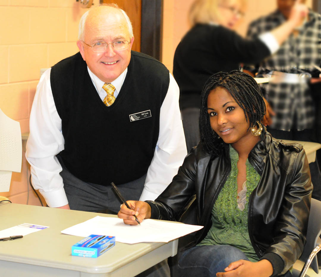 Click to enlarge,  Central Carolina Community College held its spring semester open registration Jan. 5 at its campuses in Chatham, Harnett and Lee counties. CCCC Provost Bill Tyson (left) stops to greet student Diandra Douglas, of Harnett County, as she enrolls at the Harnett County Campus for Cosmetology classes. Spring semester enrollment figures are not yet complete, but have already surpassed 4,260. The college was closed due to the inclement weather on Jan. 10-11, so the add/drop period for seated classes has been extended to 6 p.m. Jan. 19 at the Registrar's Office at the Lee County Campus.