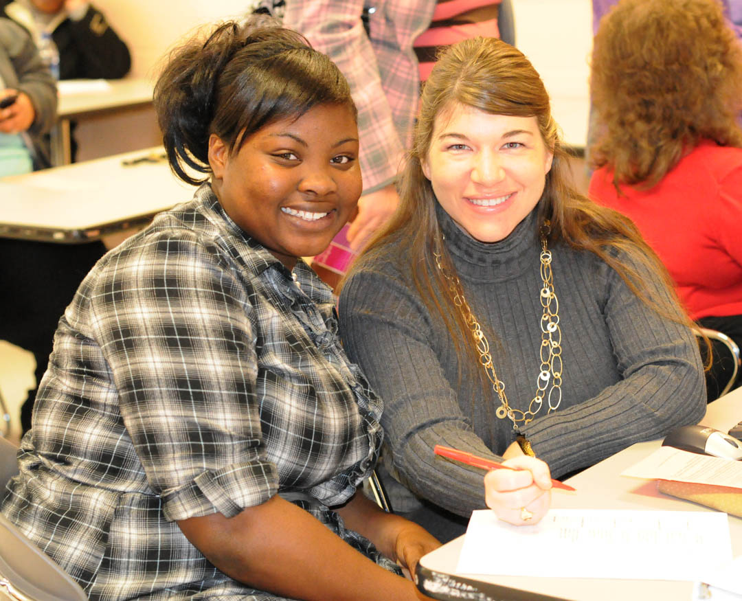 Click to enlarge,  Central Carolina Community College held its spring semester open registration Jan. 5 at its campuses in Chatham, Harnett and Lee counties. Ashley Wright (left), of Harnett County, registers at the college's Harnett Campus with the assistance of Justice Studies instructor Jamie Wicker. Spring semester enrollment figures are not yet complete, but have already surpassed 4,260. The college was closed due to the inclement weather on Jan. 10-11, so the add/drop period for seated classes has been extended to 6 p.m. Jan. 19 at the Registrar's Office at the Lee County Campus.