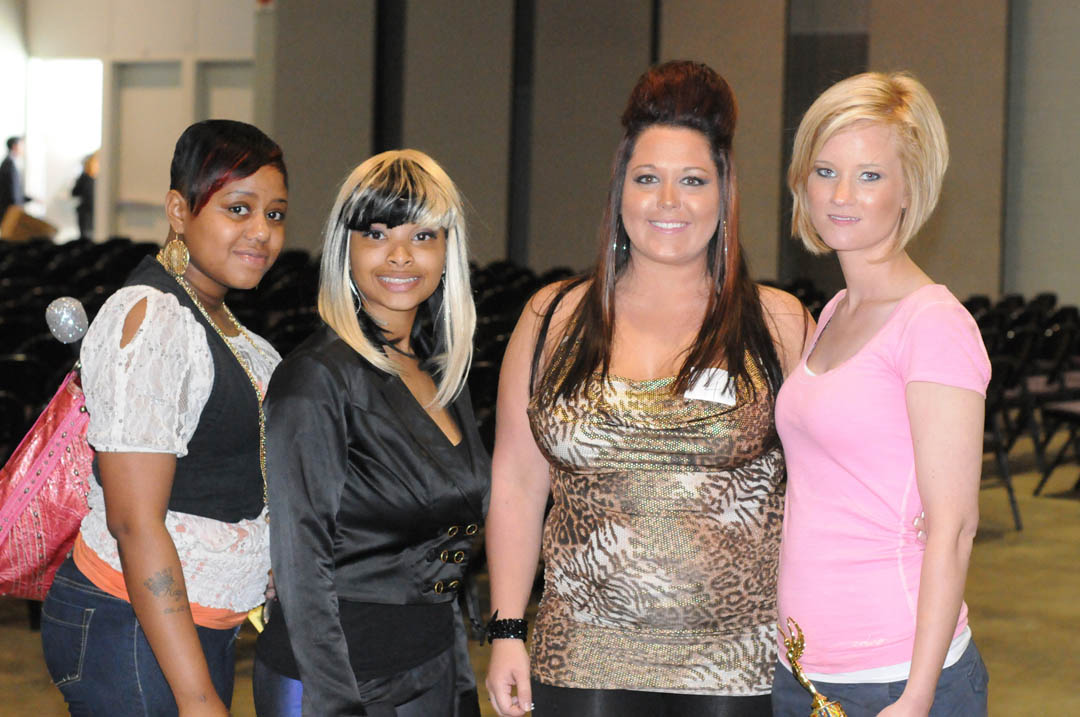 Click to enlarge,  Central Carolina Community College's fourth annual hair show competition, 'Hollywood Style,' on April 18, brought out the stars at the Dennis A. Wicker Civic Center. Cosmetology students from CCCC's Lee and Harnett campuses, its Dunn School of Cosmetology, and the college's barbering program showed off the skills they have learned and their creative talents at the fun show. Among those taking part were cosmetology students (from left) Alyson Williams, who made up Aigner Brown to look like singer Nikki Minaj, and Erin Childress, who was made up as 'Jersey Shore's' Snooki by Kelcey White. White won first place in the event's 'celebrity' category. For more information about CCCC's cosmetology program, visit the college online at  www.cccc.edu  or call (800) 682-8353.