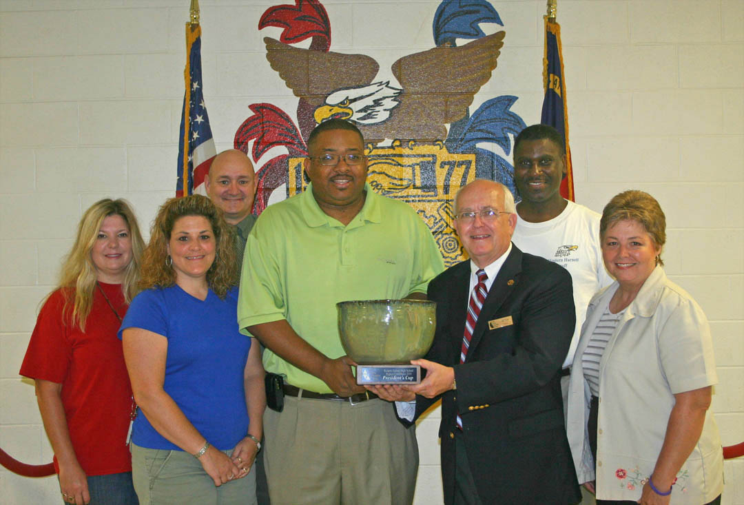 Click to enlarge,  Western Harnett High School is the first recipient of Central Carolina Community College's President's Cup, which will be presented annually to the high school having the highest percentage of graduates continuing their education at CCCC. Of Western Harnett's 242 graduates in 2010, 46 — 19 percent — enrolled at CCCC. Administrators from the college visited the high school June 13 to present the Cup. Pictured (from left) are WHHS counselors Cynthia Wood and Shannon Bradley; CCCC Dean of Vocational and Technical Programs Stephen Athans; WHHS Principal William Wright Jr., CCCC Harnett Provost Bill Tyson; WHHS counselor Reginald Lowery, and CCCC Vice President for Academic Affairs Lisa Chapman. For more information about programs at Central Carolina Community College, visit its Web site,  www.cccc.edu .