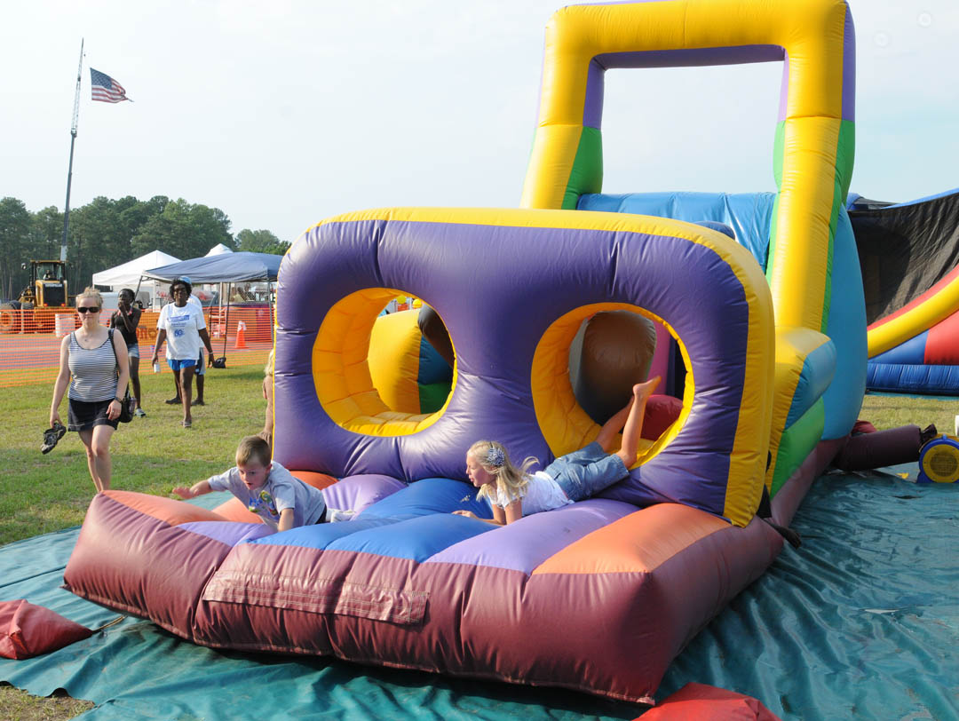 Click to enlarge,  An inflatable obstacle course proved to be a hit with kids at Central Carolina Community College's July 23 50th Anniversary kickoff celebration at the college's Emergency Services Training Center. A day of fun activities, bands, music, and skill demonstrations was topped off by a spectacular fireworks display. For more about the continuing celebration during the anniversary year, visit  www.cccc.edu/50years .