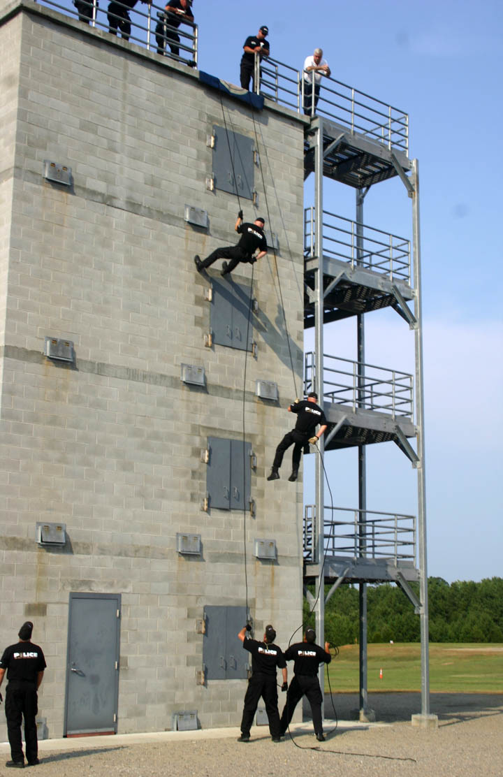 Click to enlarge,  Officers of the Sanford Police Department impressed visitors with their rappelling skills during Central Carolina Community College's 50th Anniversary kickoff celebration on July 23 at the college's Emergency Services Training Center, in Sanford. For more about the continuing celebration during the anniversary year, visit  www.cccc.edu/50years .