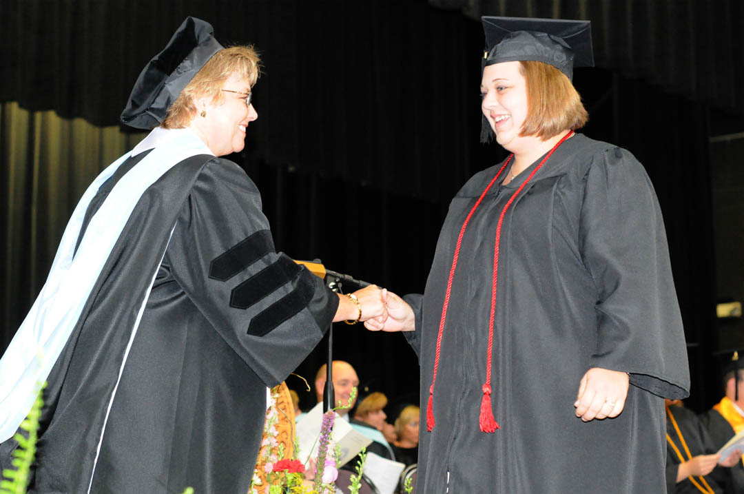 Click to enlarge,  Jessica Johnson (right), of Chatham County, receives congratulations from Central Carolina Community College Vice President for Academic Affairs Lisa Chapman during the college's Summer Commencement exercises Thursday at the Dennis A. Wicker Civic Center. Johnson received her Associate of Applied Science in Early Childhood Education. She was one of about 200 CCCC students who completed their studies during the summer semester.