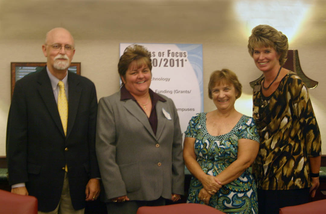 Click to enlarge,  Susan Laudate (right), of Sanford, a retired educator, became the newest member of the Central Carolina Community College Board of Trustees at its July 27 summer meeting at the Dennis A. Wicker Civic Center. Lee County Clerk of Court Susie Thomas (left) administered the oath of office to Laudate. The board also elected Julian Philpott as chairman and Tracy Hanner as vice chairman. Tony Lett was sworn in for a fourth four-year term and SGA President Donna West was sworn in as the student representative to the board.