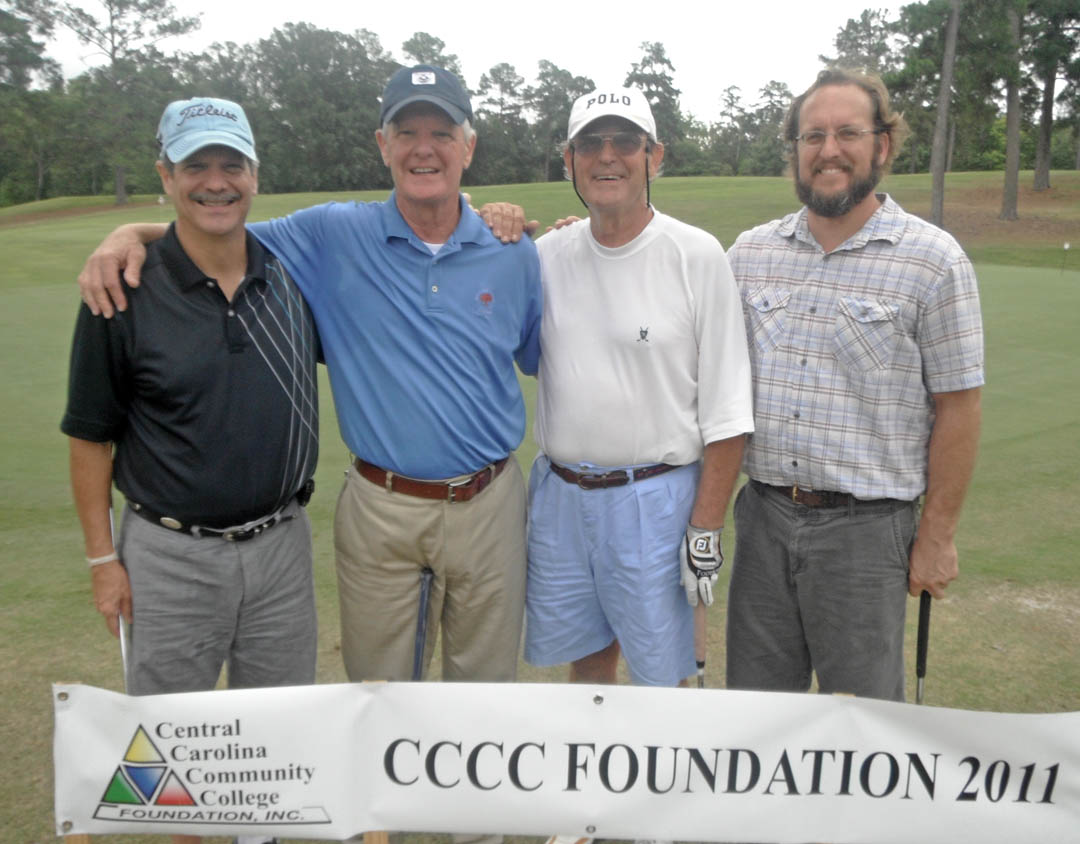 Click to enlarge,  Central Carolina Community College Foundation's 22nd Annual Golf Classic Sept. 21 attracted 172 golfers and raised $40,000 for student scholarships and award programs that advance the college's mission. Teams participated in Captain's Choice tournaments in either the morning or afternoon competitions at the Sanford Golf Course. Tying for First Place in the afternoon Third Flight was the team sponsored by Realty World-J.E. Womble & Sons: (From left) Ray Womble, Jr., George Womble, Badgett Womble, and Bob Womble, all of Harnett County.