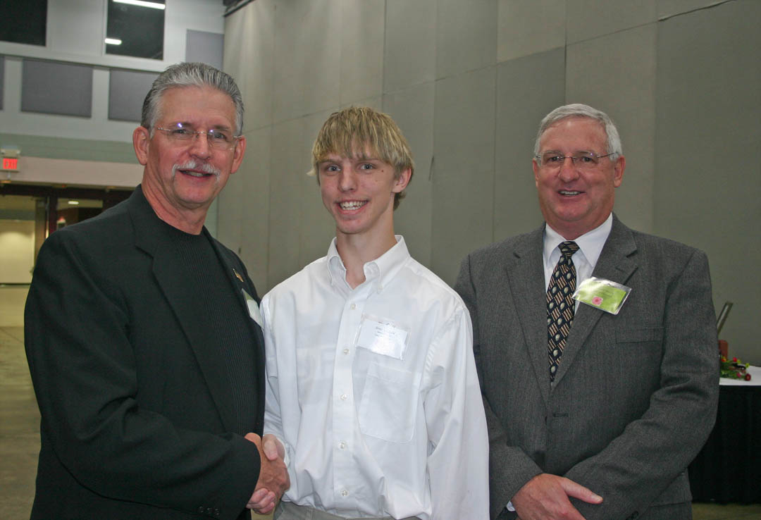 Click to enlarge,  At the CCCC Foundation Scholarship Luncheon Tuesday at the Dennis A. Wicker Civic Center, scholarship donors and recipients were able to meet each other. Laser and Photonics Technology student James Strickland, of Dunn, met (left) retired CCCC Vice President Ron Miriello, whose family established the Samuel R. Miriello Memorial Scholarship, and Laser and Photonics lead instructor Gary Beasley, representing the Laser and Photonics Technology Scholarship donors.