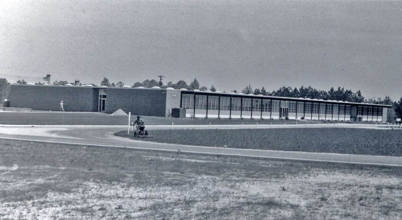 Click to enlarge,  The first building of the Lee County Industrial Education Center opened for classes in 1962. The building has been expanded and still serves as a classroom/shop facility for the institution, now known as Central Carolina Community College. The building has been named Douglas H. Wilkinson Sr. Hall in  honor of an early trustee.