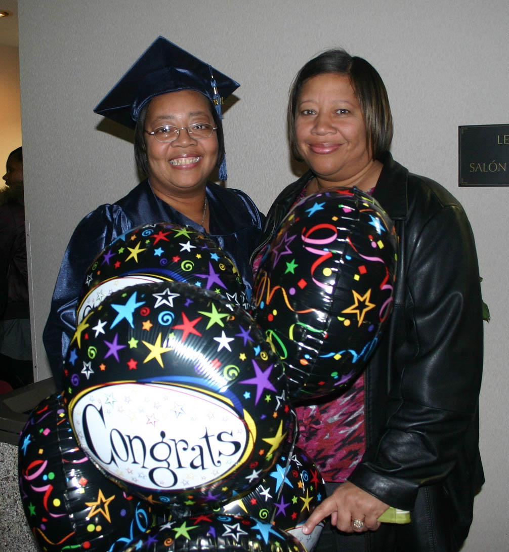 Click to enlarge,  Margery Eastman (left), of Dunn, and her sister, Michele Robinson, of Wendell, share their happiness following Central Carolina Community College's Adult High School and General Educational Development commencement exercises Thursday, Jan. 19, in the Dennis A. Wicker Civic Center. Eastman, a mother of four and grandmother of eight, finally achieved her long-time goal of receiving her GED.