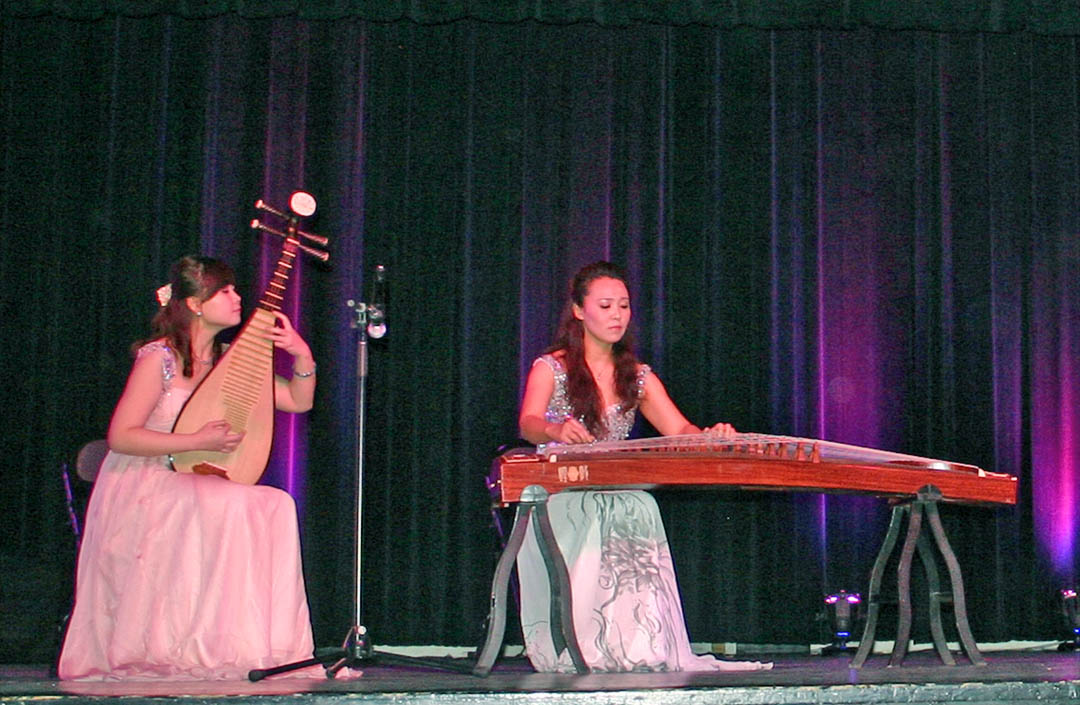 Click to enlarge,  Han Chao (left), performing on the pipa, a Chinese lute, and Jia Jiangli, playing a guzheng, a zither, perform during the Shanxi University Art Delegation show Feb. 1 at the Dennis A. Wicker Civic Center. The show, which attracted an audience of 600, included instrumental and dance numbers, as well as the creation of a piece of art. Central Carolina Community College's Confucius Classroom, in partnership with N.C. State University's Confucius Institute, sponsored the performance by professors and students of Shanxi University's School of Music. For more information on CCCC's Confucius Classroom, visit the college's Web site,  www.cccc.edu/confucius  or call (919) 718-7228 or (919) 718-7376.